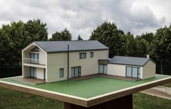 Hausmodell mit Nebengebäuden